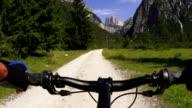 Mountainbiker in the Dolomites Mountains POV video