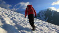 Mountaineer walking uphill on a glacier video
