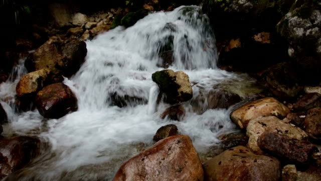 Mountains stream through rocky Alps mountains video