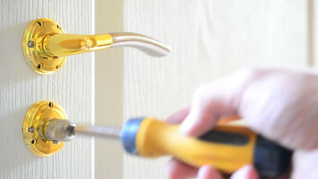 Mounting a mortise door lock. Fastening screws of door handles video