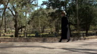 Mourning woman walks towards camera. video