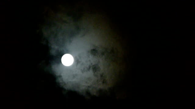 move full moon through cloudy,night flight over clouds video