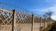 Movement along the concrete fence with barbed wire video