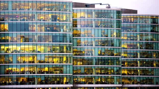 Movement of businessman meeting, Office business building in London, England - timelapse video