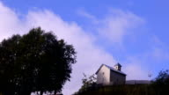 Movement of clouds over a small church. video