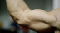 movement of muscles in the arms, on the hand of an adult male athlete, hands when driving without the fat and well developed with beautiful muscles video