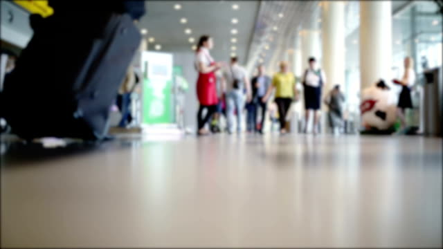 Movement of people at the airport. Blurred background video