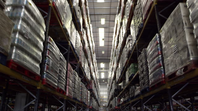 Moving along an aisle in a storage warehouse, shot on R3D video