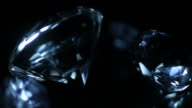 Moving blue light over precious diamonds video