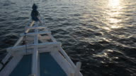 Moving boat on sunset video
