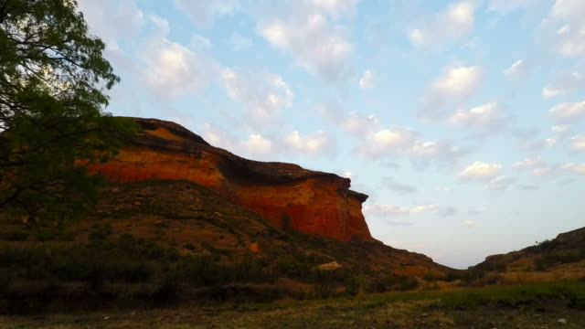 Moving clouds at sunset over rocky cliffs in the majestic Golden Gate Highlands National Park, South Africa. Time lapse video. video