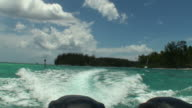 Moving from a Polynesian motu to another; boat wake video