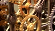 Moving gears of old mechanism close up video