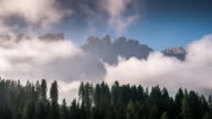 Moving of mist Time Lapse of lake carezza dolomites european alps Italy video