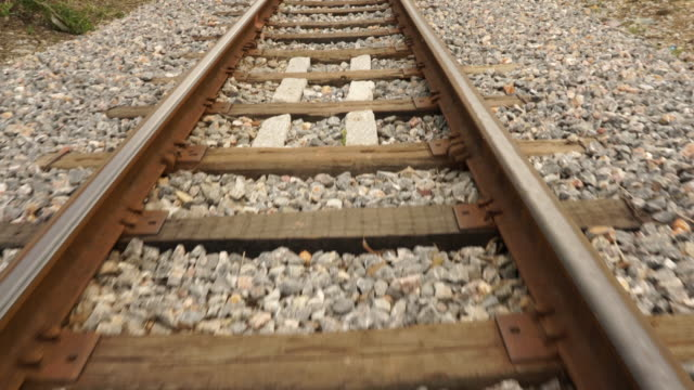 Moving on train tracks at walking speed, camera on stabilizer video