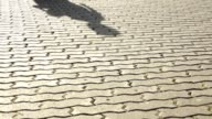 Moving shadows and legs of walking children. video