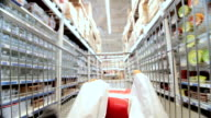 Moving shopping cart in supermarket video