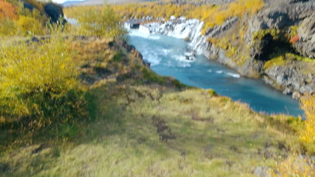 moving shot of Hraunfossar waterfall in western of Iceland in autumn sunny day video