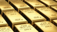 Moving stacks of gold bars video