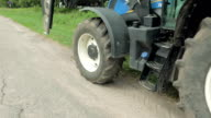 Moving tractor with blades and drawbar trailer video