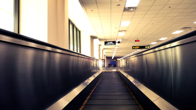 Moving walkway in airport with vintage light video