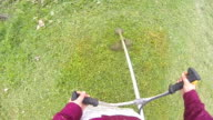 mowing grass in slow motion video