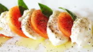 Mozzarella cheese with tomatoes olive oil and basil leaves video