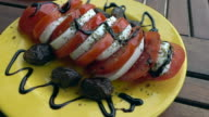 Mozzarella Cheese With Tomatoes, Sun-dried Olives, Balsamic Cream and Oil video