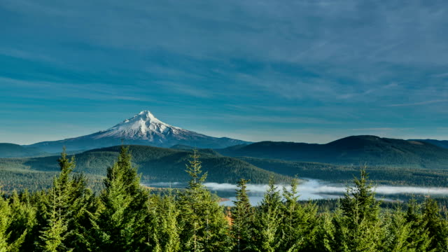 Mt. Hood Time Lapse with Clearing Fog Over Lake video