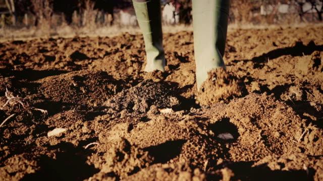 Muddy gardening boots video