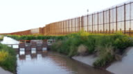A Muddy River and Large Fence Separates Two Countries video