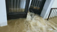 Muddy water pouring through the entrance door video