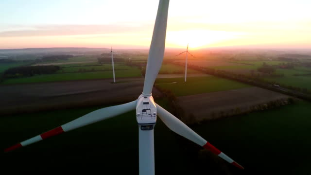 Muensterland, Germany - 20 April 2015, Wind turbines at sunset producing renewable energy video