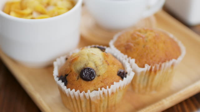 Muffin cake for breakfast time on wooden dish , dolly shot right to left video