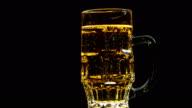 A Mug of Beer on a Black Background video
