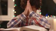 Mulatto boy praying. video