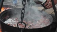 Mulled wine cooks in a big copper at Christmas fair video