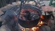 Mulled wine cooks in a big copper video