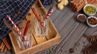 Mulled wine is poured into glasses, around are ingredients video