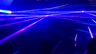 Multi coloured lasers in nightclub party video