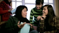 Multi ethnic Asian girls teaching and learning together. video