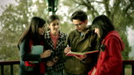 Multi ethnic Asian university students teaching and learning together. video