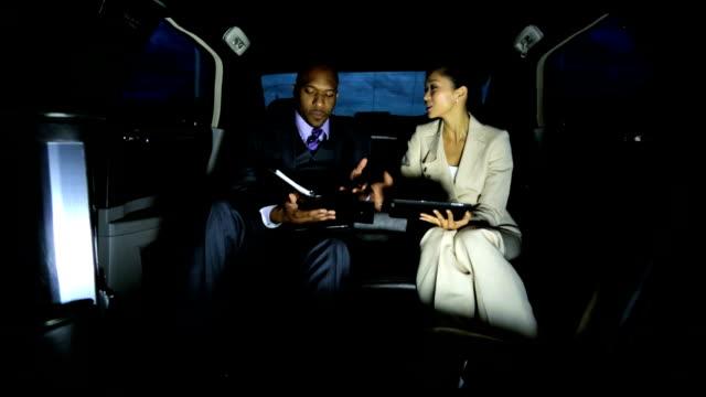 Multi Ethnic Business Executives Using Limousine video