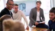 Multi ethnic business team members attending presentation in meeting room video