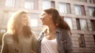 Multi ethnic friends walking in city video
