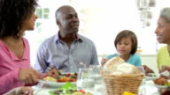 Multi Generation African American Family Eating Meal At Home video