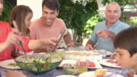 Multi Generation Family Enjoying Meal On Terrace Together video