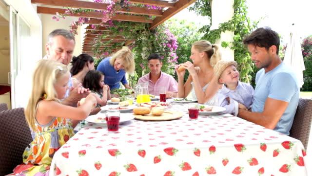 Multi Generation Family Enjoying Outdoor Meal video