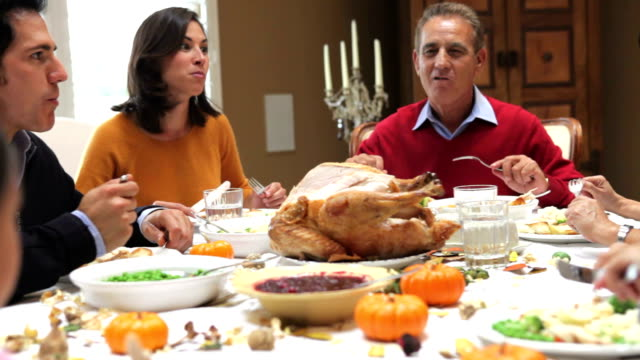 Multi Generation Family Enjoying Thanksgiving Meal video
