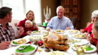 Multi Generation Family Enjoying Thanksgiving Meal video